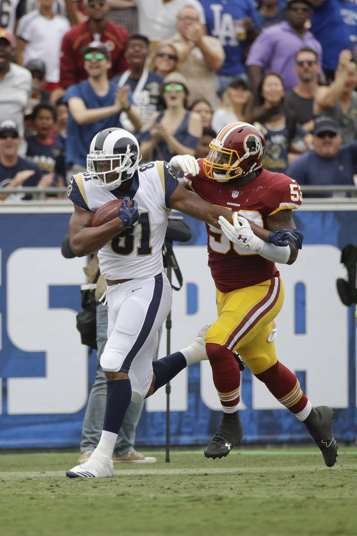 Los Angeles Rams' Gerald Everett, left, carries the ball against Washington Redskins' Zach Brown during an NFL football game Sunday, Sept. 17, 2017, in Los Angeles. (AP Photo/Jae C. Hong)