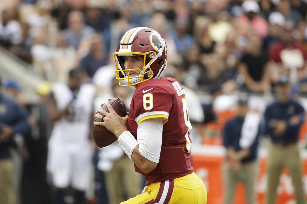 Washington Redskins quarterback Kirk Cousins looks to throw a pass during an NFL football game against the Los Angeles Rams Sunday, Sept. 17, 2017, in Los Angeles. (AP Photo/Jae C. Hong)