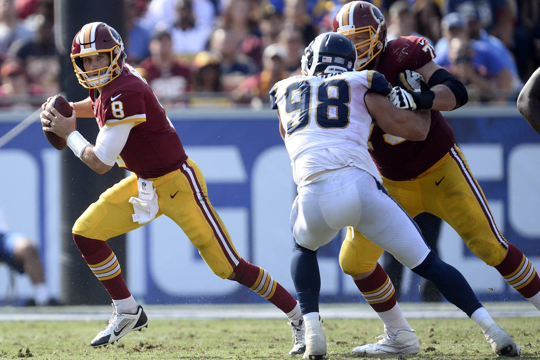September 17, 2017; Los Angeles, CA, USA; Washington Redskins quarterback Kirk Cousins (8) rolls out as offensive tackle Trent Williams (71) blocks Los Angeles Rams outside linebacker Connor Barwi ...