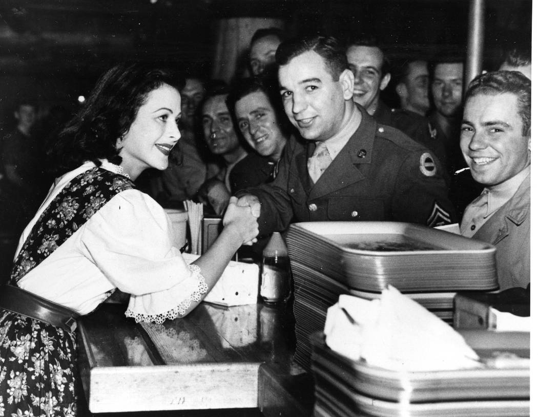 Hedy Lamarr shakes hands with a soldier at the Hollywood Canteen where the actress appears as a United Service Organizations (USO) volunteer on Nov. 17, 1942.  (AP Photo)
