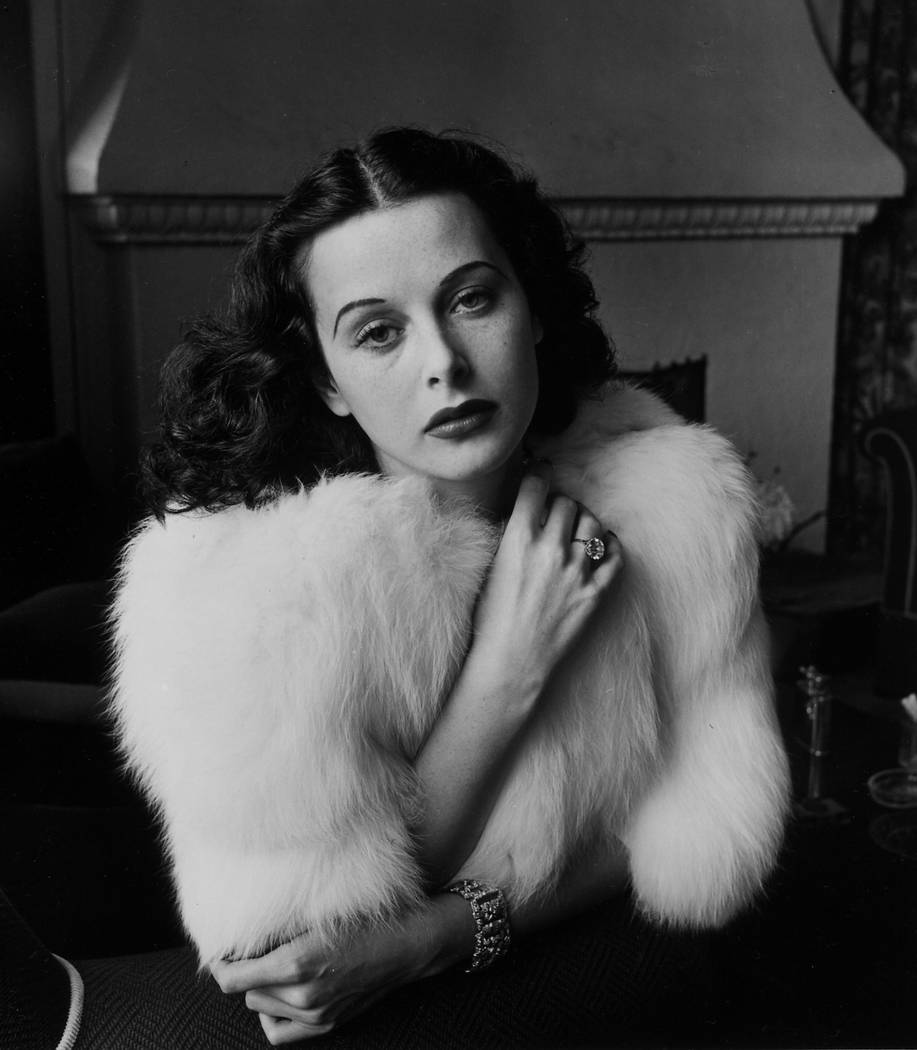 Glamorous portrait of movie actress Hedy Lamarr wearing white fox fur short jacket.