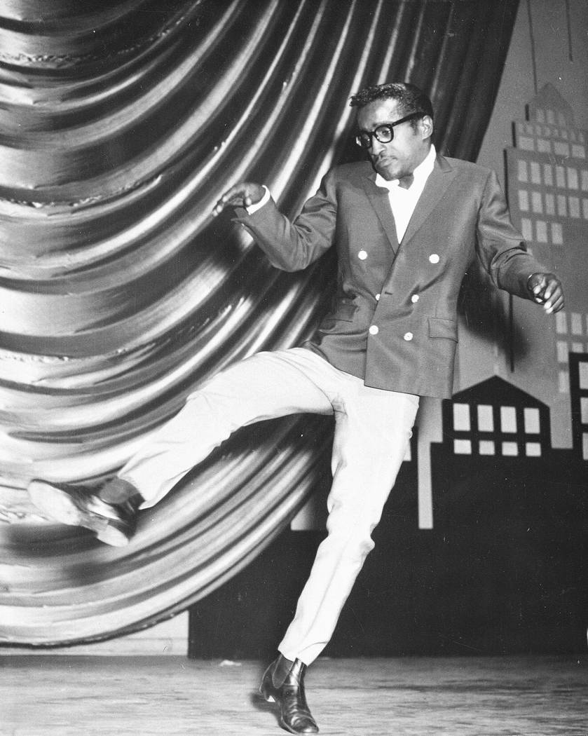 American entertainer Sammy Davis Jr. is seen dancing on stage at the Victoria Palace in London, during a rehearsal for a Royal Variety performance on May 19, 1960.  (AP Photo)
