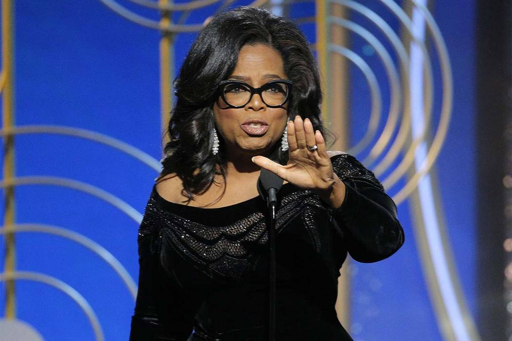 Oprah Winfrey accepts the Cecil B. DeMille Award at the 75th Annual Golden Globe Awards in Beverly Hills, Calif., on Sunday, Jan. 7, 2018. (Paul Drinkwater/NBC via AP)