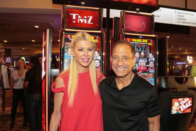 Tara Reid and TMZ chief Harvey Levin at the Aug. 29 launch of TMZ slots at the Hard Rock Hotel. (Edison Graf for Kabik Photo Group)