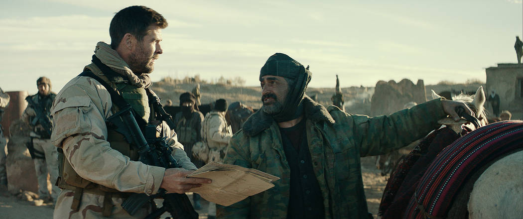 """CHRIS HEMSWORTH, left, as Captain Mitch Nelson and NAVID NEGAHBAN as General Dostum in """"12 STRONG,"""" (Warner Bros. Pictures)"""