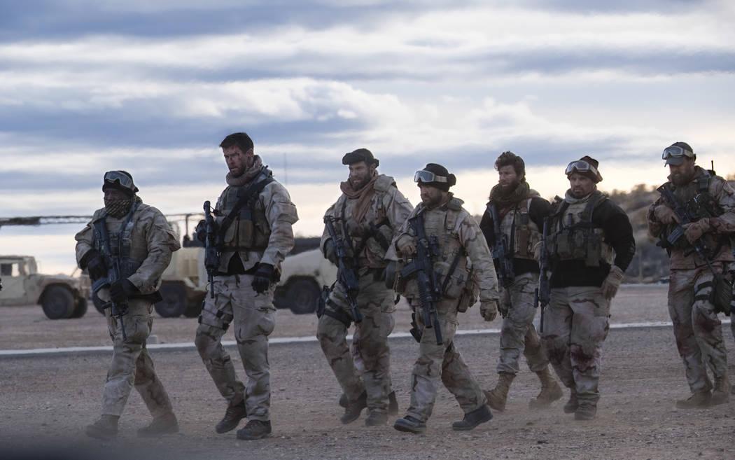 From left, TREVANTE RHODES as Ben Milo, CHRIS HEMSWORTH as Captain Mitch Nelson, GEOFF STULTS as Sean Coffers, AUSTIN HÉBERT as Pat Essex, AUSTIN STOWELL as Fred Falls, MICHAEL PEÑA as Sam Dille ...