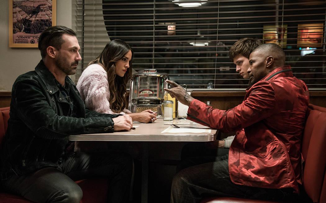 "Buddy (Jon Hamm), Darling (Eiza Gonzalez), Baby (Ansel Elgort) and Bats (Jamie Foxx) discuss the next heist in TriStar Pictures' ""Baby Driver."""