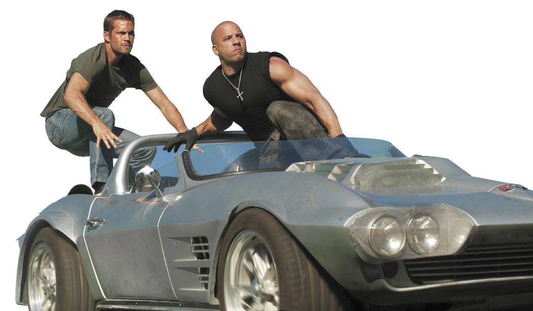 """(L to R) Brian O'Conner (PAUL WALKER) and Dom Toretto (VIN DIESEL) in a reunion of returning all-stars from every chapter of the explosive franchise built on speed--""""Fast Five""""."""