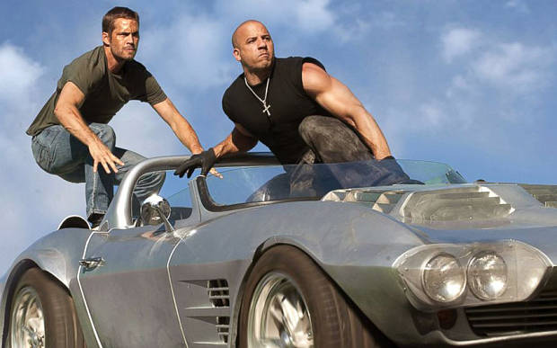 """Brian O'Conner (Paul Walker) and Dom Toretto (Vin Diesel) in a reunion of returning all-stars from every chapter of the explosive franchise built on speed """"Fast Five."""""""