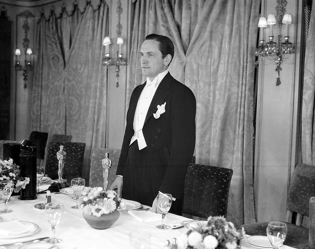 """Fredric March acknowledges the applause during dinner of the 1931-32 Motion Picture Academy Awards at the Ambassador Hotel in Hollywood, Ca., Nov. 18, 1932.  March won for best actor in """" ..."""