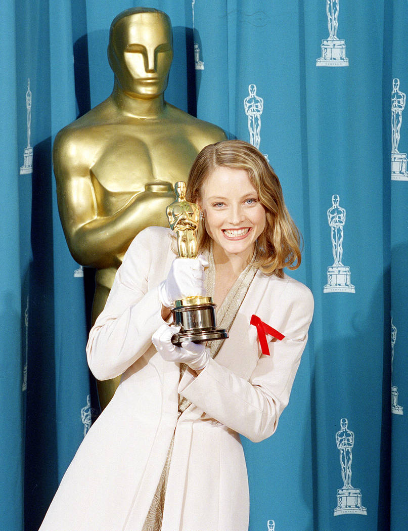 """Jodie Foster shows off her Oscar backstage at the 64th annual Academy Awards in Los Angeles, Ca., March 30, 1992.  Foster won best actress in a leading role for her performance in """"Silenc ..."""