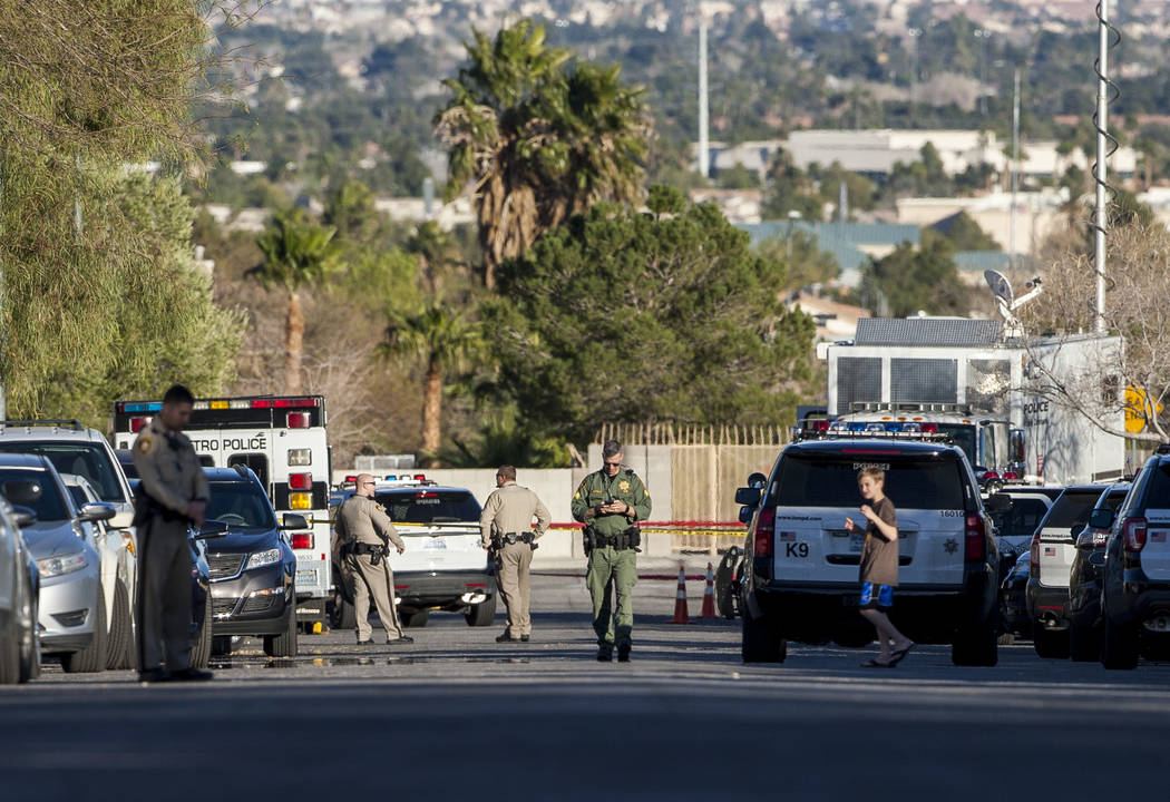 The Metropolitan Police Department investigates an officer-involved shooting near Lingo Street in northwest Las Vegas on Tuesday, Feb. 6, 2018. (Patrick Connolly/Las Vegas Review-Journal) @PConnPie