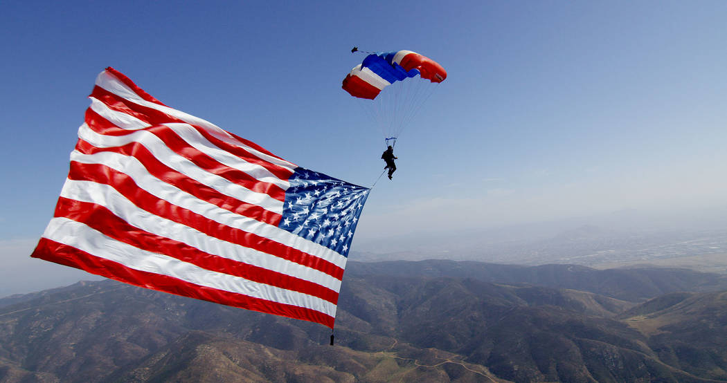 Skydiving Innovations flies the flag at opening ceremonies. Image: Polo America/Kim Kumpart Photography