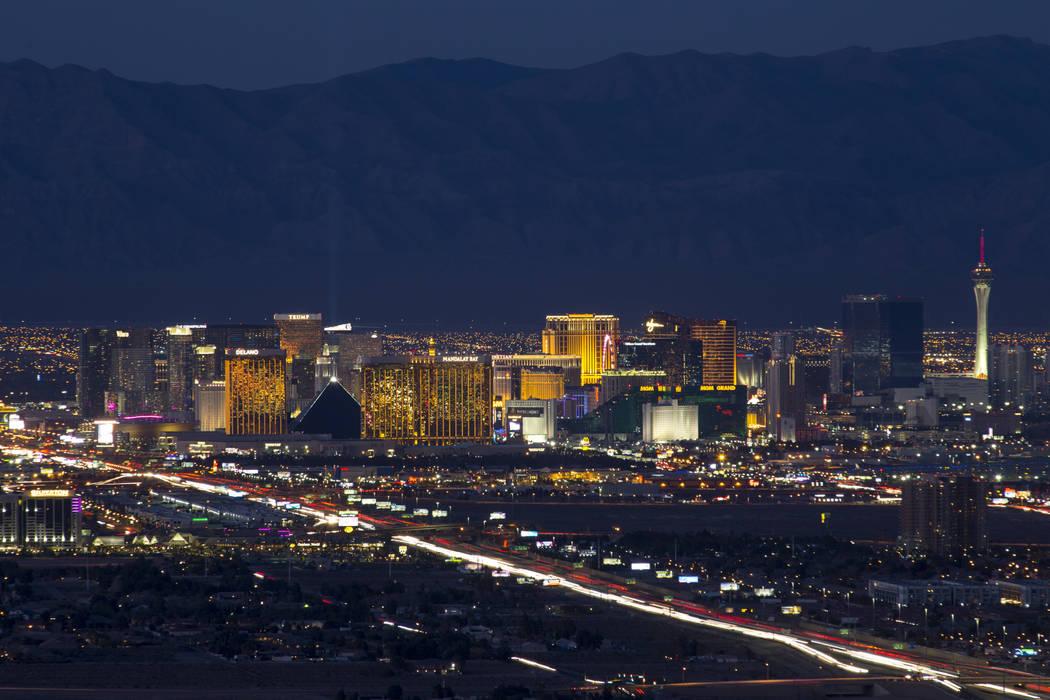 Traffic moves along Interstate 15 as Las Vegas casinos illuminate the city's skyline at dusk on Tuesday, Feb. 6, 2018. Richard Brian Las Vegas Review-Journal @vegasphotograph