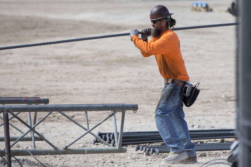 A worker handles a steel rod at the future Raiders stadium site in Las Vegas, Tuesday, March 6, 2018. (Erik Verduzco/Las Vegas Review-Journal) @Erik_Verduzco