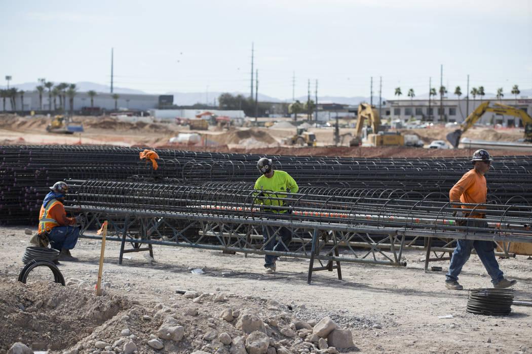 Workers handle steel rods at the future Raiders stadium site in Las Vegas, Tuesday, March 6, 2018. (Erik Verduzco/Las Vegas Review-Journal) @Erik_Verduzco