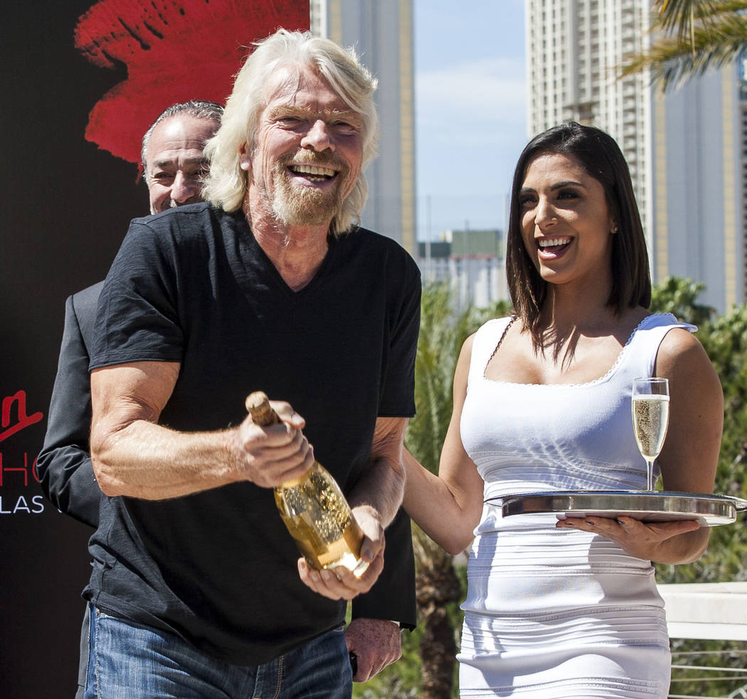 Virgin Group Founder Sir Richard Branson prepares for a champagne toast at a press conference at the Hard Rock Hotel in Las Vegas on Friday, March 30, 2018.  Patrick Connolly Las Vegas Review-Jour ...