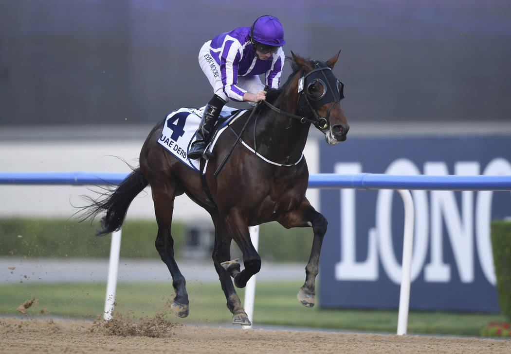Mendelssohn with jockey Ryan Moore gallops to the wire to win the $2 million Group 2 UAE Derby over 1900m in Dubai, the United Arab Emirates, Saturday, March 31, 2018. (AP Photo/Martin Dokoupil)