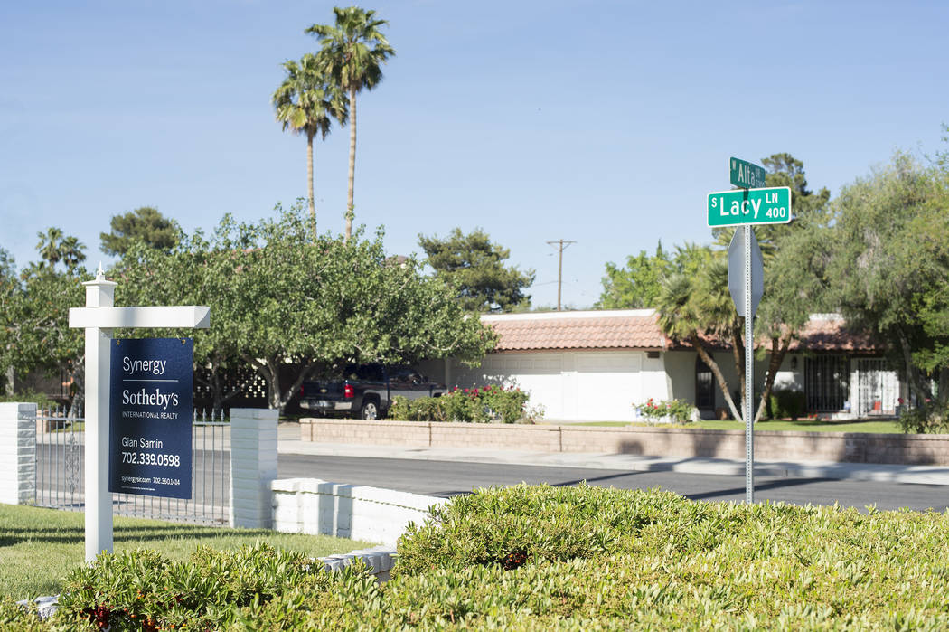 """A """"for sale"""" sign sit out front a home near the intersection of Lacy Lane and Alta Drive on Wednesday, May 3, 2017, in Las Vegas. Bridget Bennett Las Vegas Review-Journal @bridgetkbennett"""