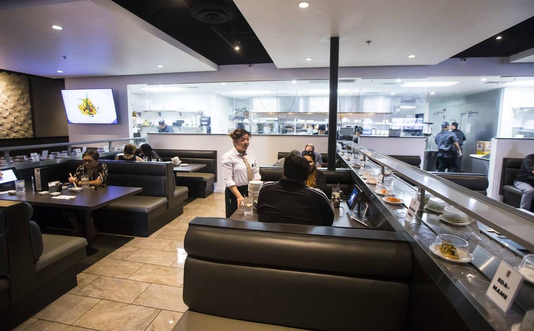 Fae Domingo, center, assists diners at Sapporo Revolving Sushi in Las Vegas on Wednesday, April 25, 2018. Chase Stevens Las Vegas Review-Journal @csstevensphoto