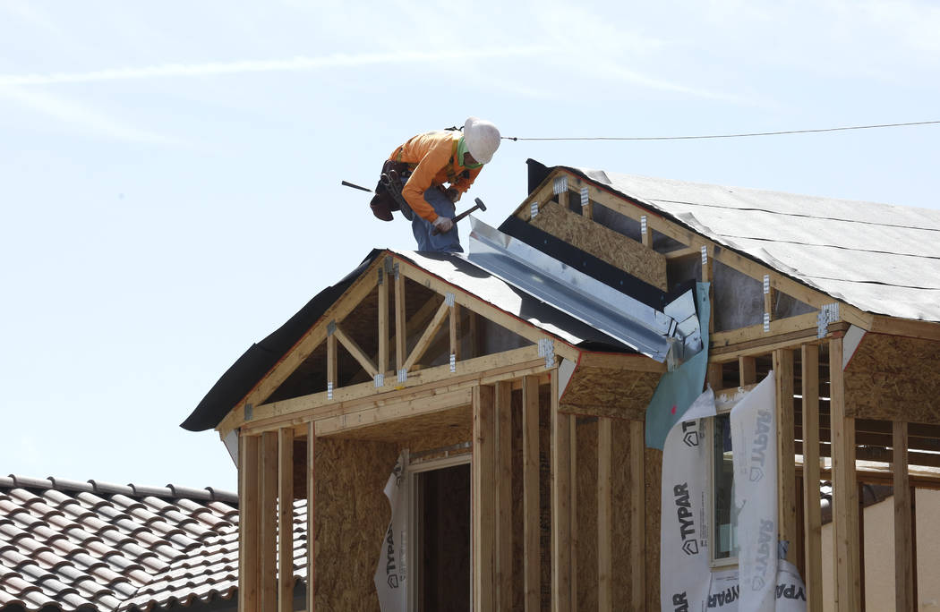 A construction worker puts a roof on a new home at the Cove at Southern Highlands and St. Rose parkways on Wednesday, April 18, 2018, in Las Vegas. Bizuayehu Tesfaye/Las Vegas Review-Journal @bizu ...