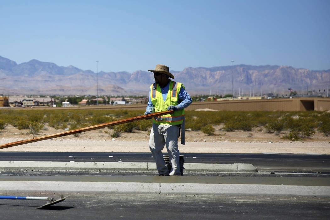 An employee works on a road-widening project near an undeveloped stretch on Las Vegas Boulevard in Las Vegas on Friday, April 27, 2018. Andrea Cornejo Las Vegas Review-Journal @dreacornejo