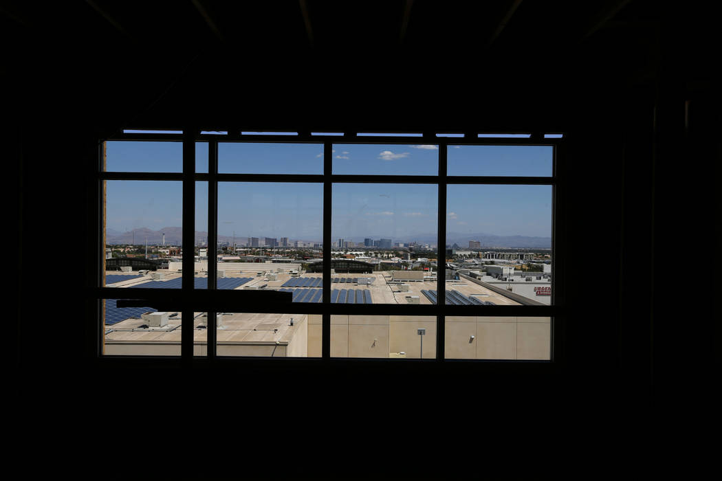 A view of the Strip is seen from a common area in the under construction 365-unit Elysian apartment complex on the southeast corner of Flamingo Road and Hualapai Way in Las Vegas Friday, April 27 ...