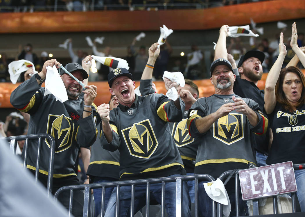 Golden Knights fans celebrate a goal by Golden Knights center William Karlsson, not pictured, during the first period of Game 2 of an NHL hockey second-round playoff series against the San Jose Sh ...