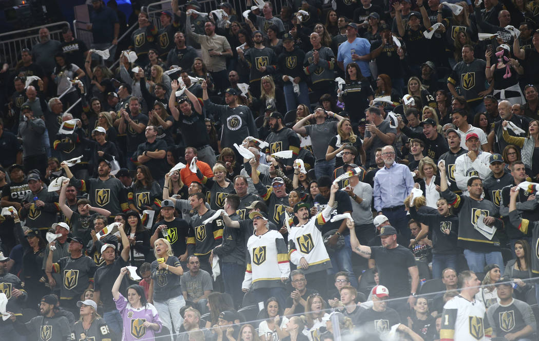Golden Knights fans react during the first overtime period of Game 2 of an NHL hockey second-round playoff series against the San Jose Sharks at T-Mobile Arena in Las Vegas on Saturday, April 28, ...