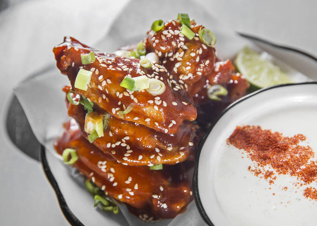 Spicy Korean BBQ wings with scallion and toasted sesame seeds with buttermilk-dill dressing at Black Tap on Monday, May 7, 2018, at The Venetian hotel-casino, in Las Vegas. Benjamin Hager Las Vega ...