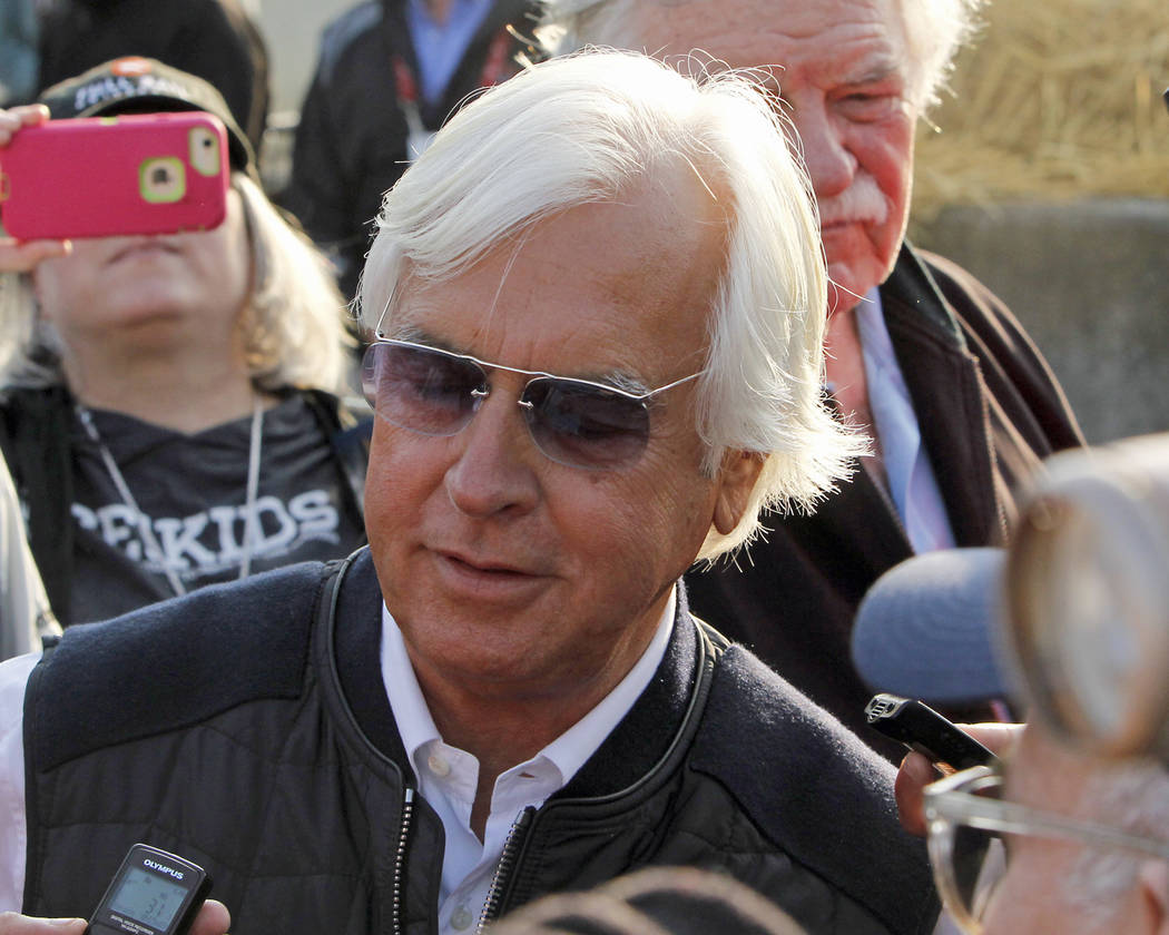 Hall of Fame trainer Bob Baffert answers questions from the media outside Barn 33 after winning his fifth Kentucky Derby on Saturday with Justify at Churchill Downs in Louisville, Ky., Sunday, May ...