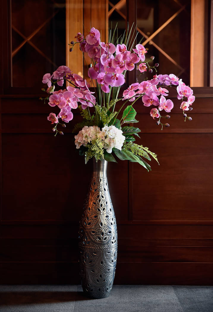 A display of life-like orchids decorate the dinning room at Lotus of Siam restaurant Friday, May 11, 2018, in Las Vegas. David Becker/Las Vegas Review-Journal Follow @davidjaybecker