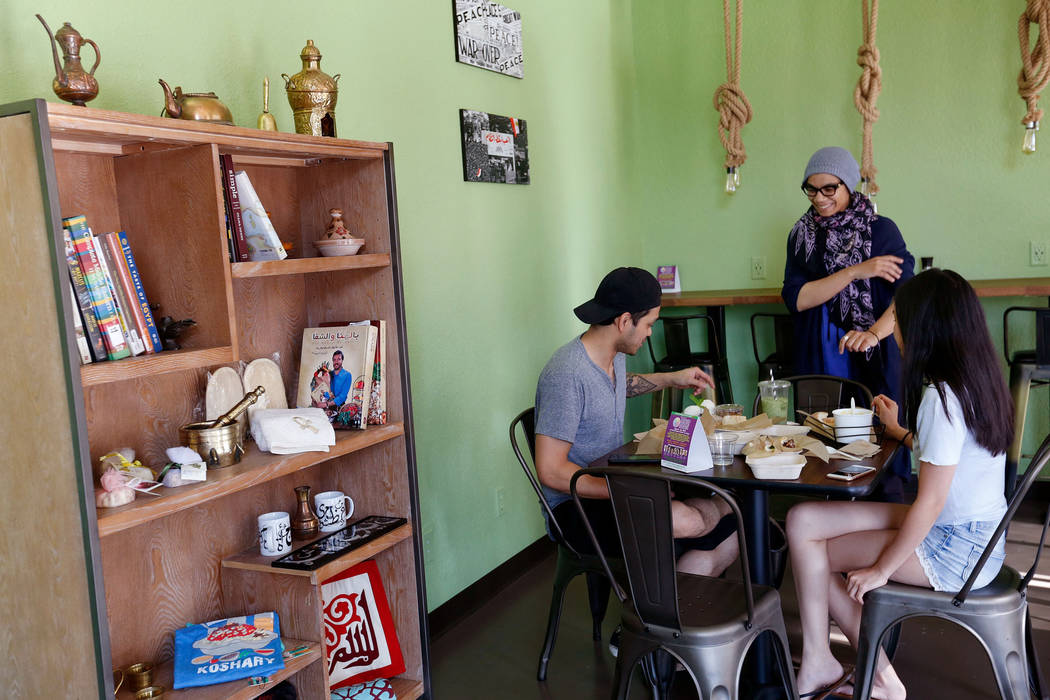 Pots owner/chef Iman Haggag, center, speaks to her customers Gray Murillo of Las Vegas and his wife Kalei Nishimura at the restaurant in Las Vegas, Thursday, June 7, 2018. Pots is a vegan and vege ...