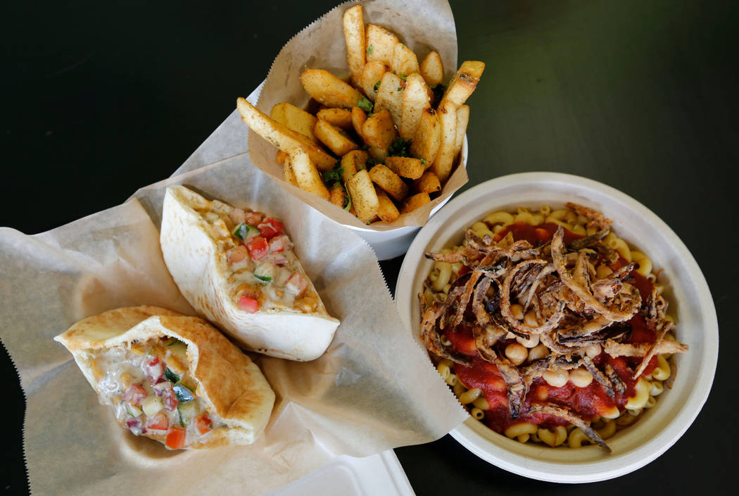 Ful Mudammas, from left, Egyptian Fries and Koshari are served at Pots in Las Vegas, Thursday, June 7, 2018. Pots is a vegan and vegetarian restaurant, which serves Egyptian cuisine. (Chitose Suzu ...