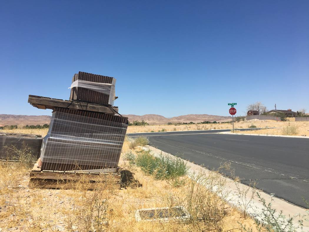 Texas homebuilder D.R. Horton acquired dozens of lots in Valley Heights, a mostly empty subdivision in the rural town of Logandale. Pallets of roof shingles are seen in Valley Heights on Tuesday, ...
