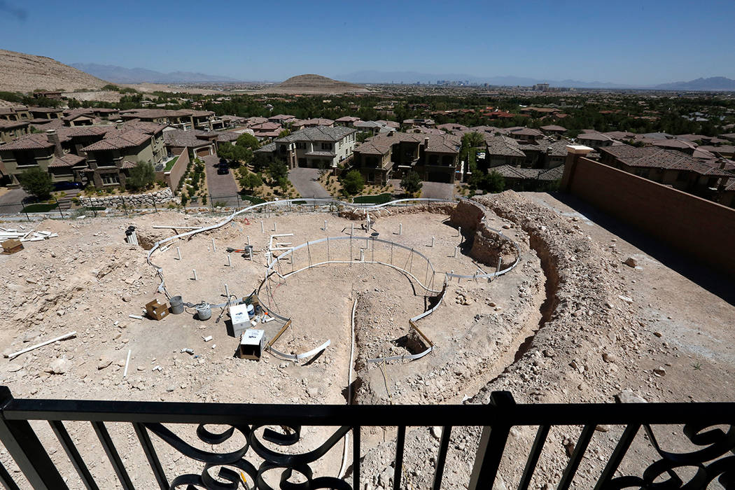 The Las Vegas Strip is seen as a swimming pool is under construction by Poolscapes in a new house in Southern Highlands on Tuesday, July 3, 2018, in Las Vegas. Bizuayehu Tesfaye/Las Vegas Review-J ...