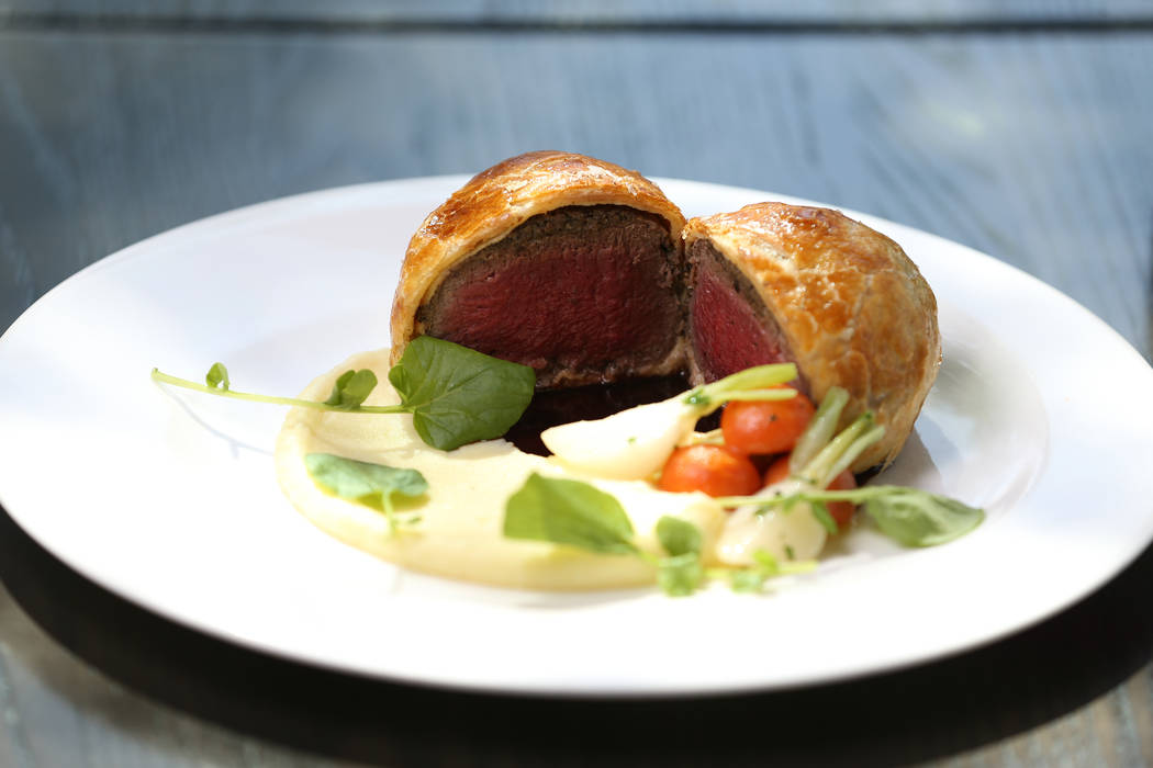 The beef wellington, served with potato puree, glazed root vegetables and red wine demi glace, at Gordon Ramsay Hell's Kitchen in Las Vegas, Tuesday, July 17, 2018. Erik Verduzco Las Vegas Review- ...