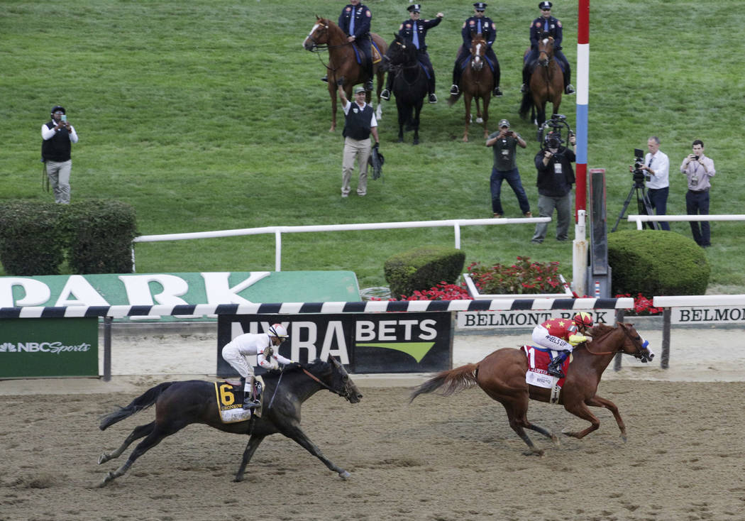 Justify (1), with jockey Mike Smith up, crosses the finish line to win the Triple Crown at the 150th running of the Belmont Stakes horse race, Saturday, June 9, 2018, in Elmont, N.Y. Gronkowski (6 ...