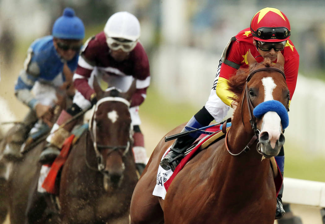 In this June 9, 2018, file photo, Justify (1), with jockey Mike Smith up, leads the field as it approaches the first turn during the 150th running of the Belmont Stakes horse race in Elmont, N.Y. ...