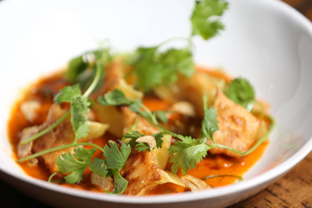 The scallop and shrimp dumplings are served with sudado stew sauce and crispy garlic, at the Palazzo hotel-casino in Las Vegas, Wednesday, Aug. 1, 2018. Erik Verduzco Las Vegas Review-Journal @Eri ...