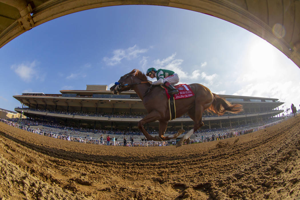In a photo provided by Benoit Photo, Catalina Cruiser and jockey Drayden Van Dyke win the Grade II, $200,000 Pat O'Brien Stakes horse race Saturday, Aug. 25, 2018, at Del Mar Thoroughbred Club in ...