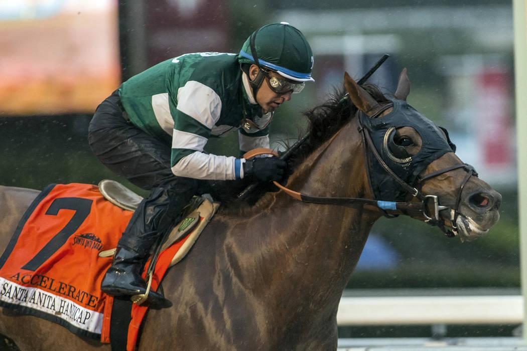 In this image provided by Benoit Photo, Accelerate, with Victor Espinoza aboard, wins the Grade I, $600,000 Santa Anita Handicap horse race Saturday, March 10, 2018, at Santa Anita Park in Arcadia ...
