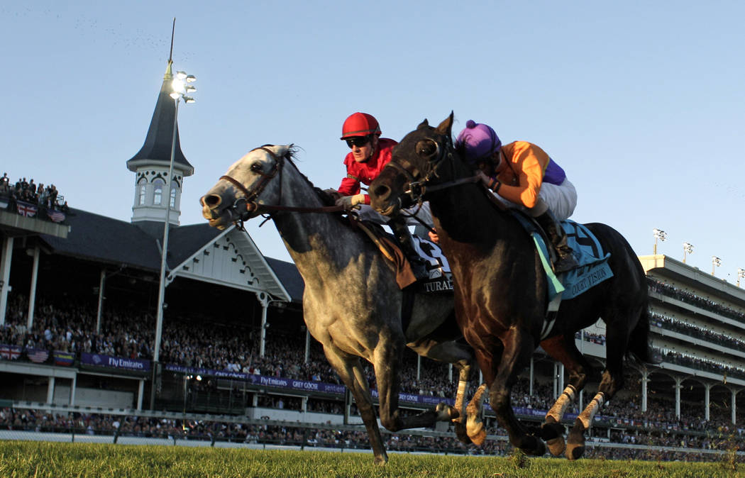 Robby Albarado riding Court Vision, right, passes Julien Leparoux riding Turallure during the Mile race at the Breeders' Cup horse races at Churchill Downs Saturday, Nov. 5, 2011, in Louisville, K ...