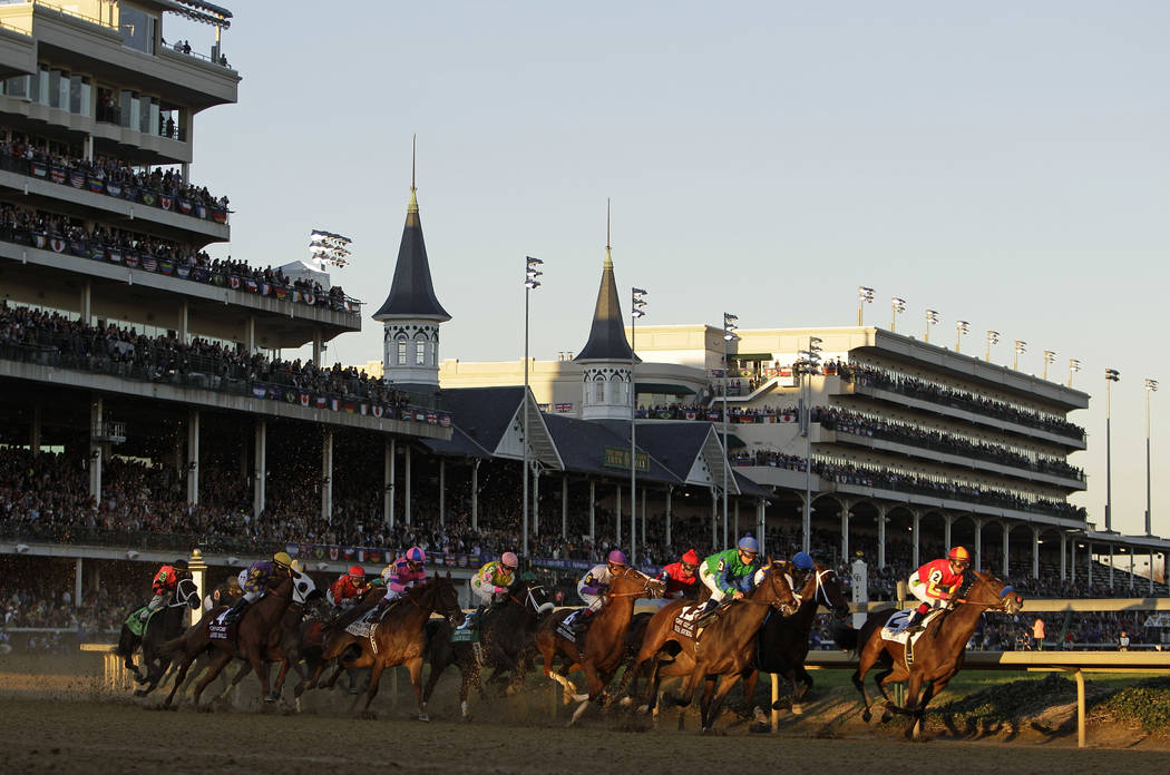 FILE - In this Nov. 4, 2011, file photo, horses make their way around turn one during the Juvenile Fillies race at the Breeders' Cup horse races at Churchill Downs in Louisville, Ky. There's littl ...