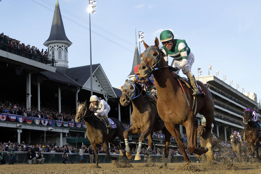 Joel Rosario rides Accelerate to victory in the Breeders' Cup Classic horse race at Churchill Downs, Saturday, Nov. 3, 2018, in Louisville, Ky. (AP Photo/Darron Cummings)