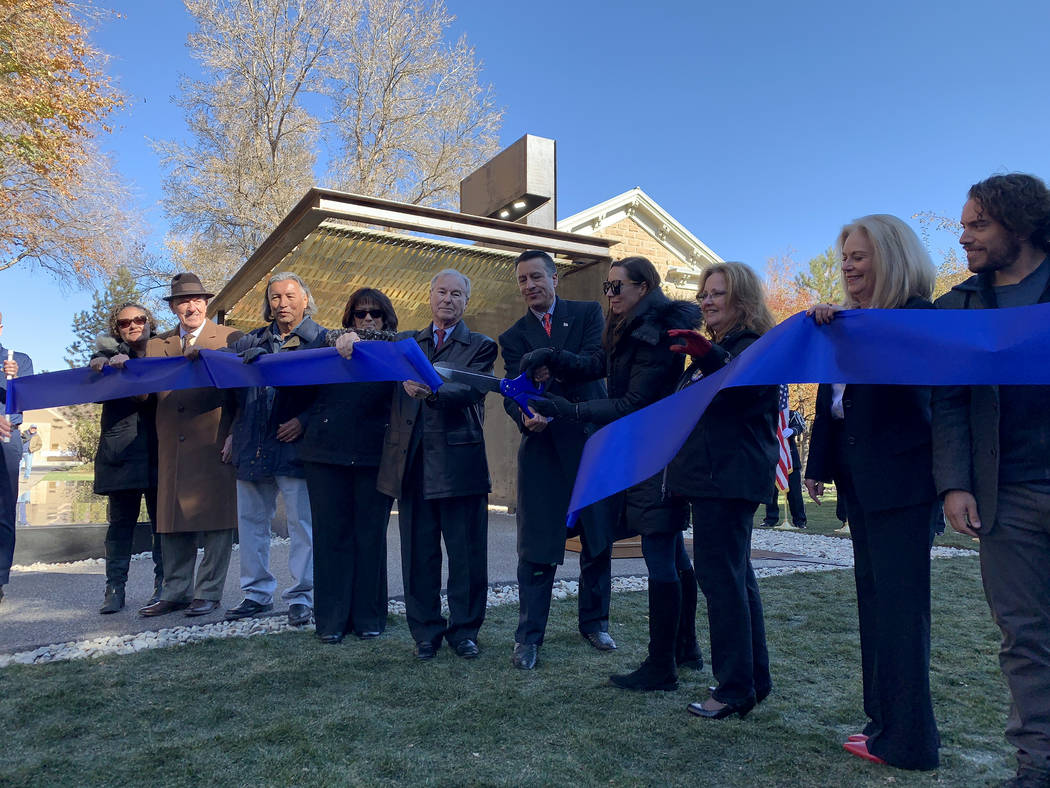Gov. Brian Sandoval, state Sen. David Park, representatives of Nevada veterans groups and others cut the ribbon at the official opening on the the state's Battle Born Memorial to fallen service pe ...