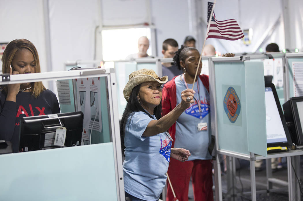 Volunteer Leah Barney, middle, directs voters to open machines at the voting station at 7881 W. Tropical Pkwy. on Tuesday, November 6, 2018, in Las Vegas. (Benjamin Hager/Las Vegas Review-Journal)