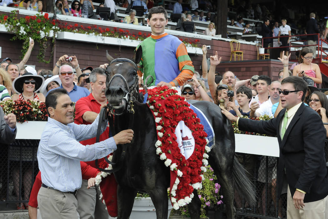 Golden Ticket with Jockey David Cohen, who finished in a dead heat with Alpha and Jockey Ramon Dominguez in the winners circle after winning the Travers Stakes horse race at Saratoga Race Course ...