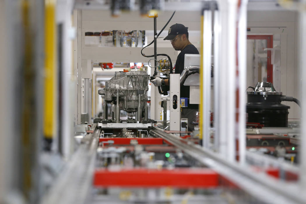 Kris Salcedo works on drive units at the Tesla Gigafactory, east of Reno, Nev., on Tuesday, Dec. 4, 2018. Cathleen Allison Special to Las Vegas Review-Journal