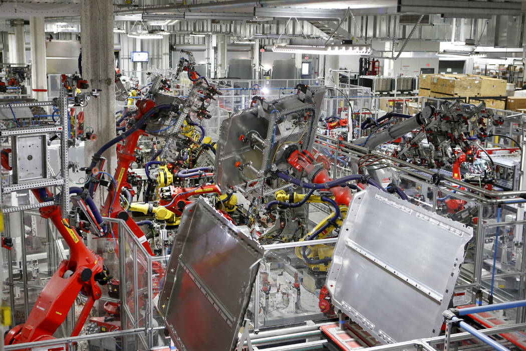 Robots work in many areas of the Tesla Gigafactory, east of Reno, Nev., on Tuesday, Dec. 4, 2018. Cathleen Allison Special to Las Vegas Review-Journal